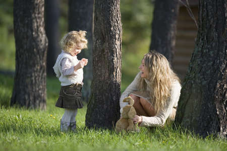 kind hearted: Mother playing with daughter in wood