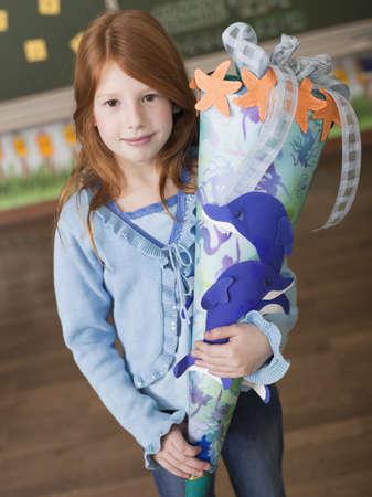 gratify: Girl holding schoolcone