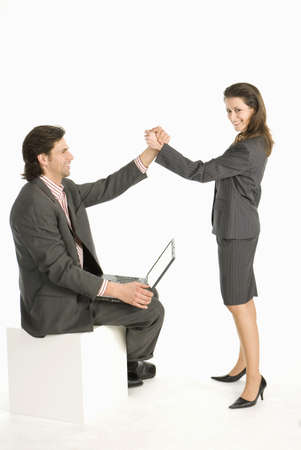 hope indoors luck: Business colleagues giving high five, smiling, side view