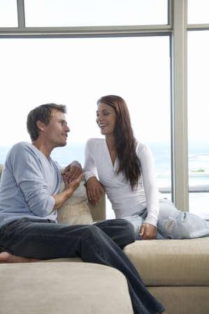Couple sitting on sofa Stock Photo - 23853235