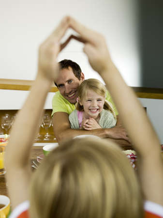 Father and children at breakfast table Stock Photo - 23853294