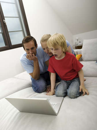 Family using laptop Stock Photo - 23853298
