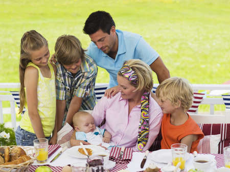 coherence: Family in garden with baby