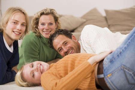 upper floor: Family lying on floor in living room