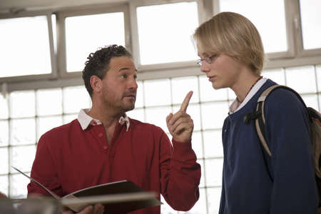 argue kid: Father advising son (16-17) low angle view