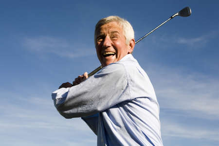 only one senior: Senior adult man holding golf club