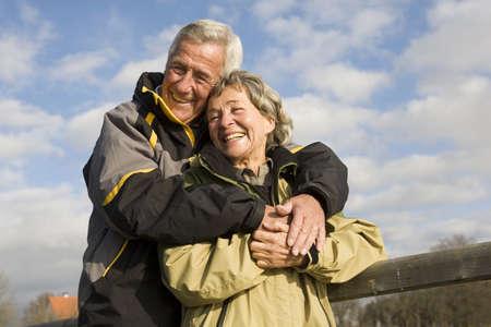 embracement: Senior couple, man embracing woman LANG_EVOIMAGES