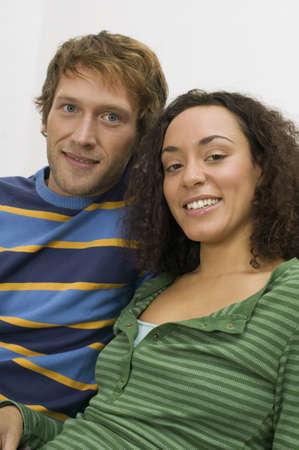 embracement: Young couple, portrait LANG_EVOIMAGES