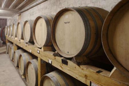 juxtaposing: Wine casks in cellar