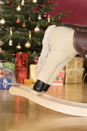 traditon: Rocking horse standing by Christmas tree, detail