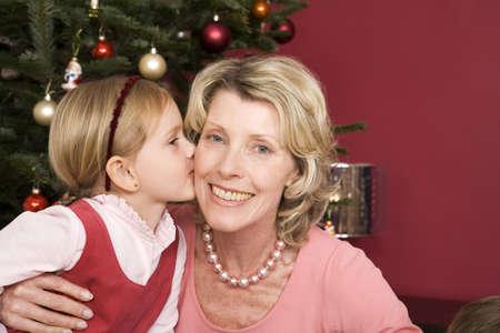 embracement: Girl (3-5) kissing grandmother, close-up LANG_EVOIMAGES