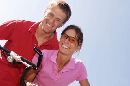 confiding: Couple with bicycle LANG_EVOIMAGES