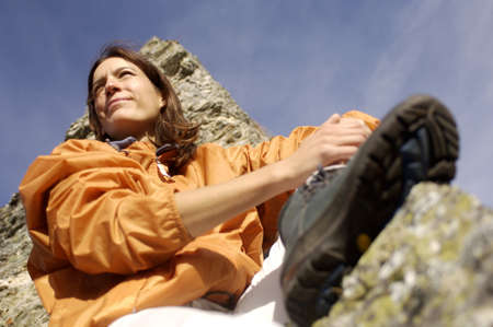 scenaries: Woman resting in mountains, view from below, close-up LANG_EVOIMAGES