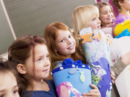 Pupils holding schoolcone LANG_EVOIMAGES