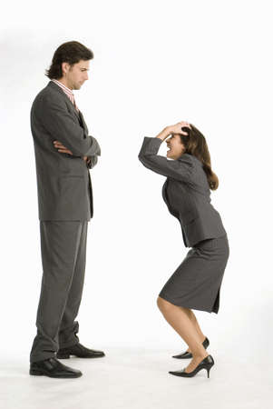 dissension: Businesswoman laughing at businessman, side view