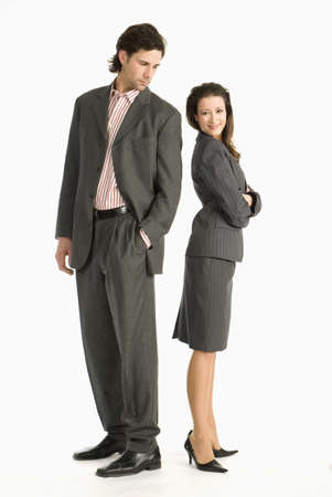 grudging: Two businesspeople standing back to back