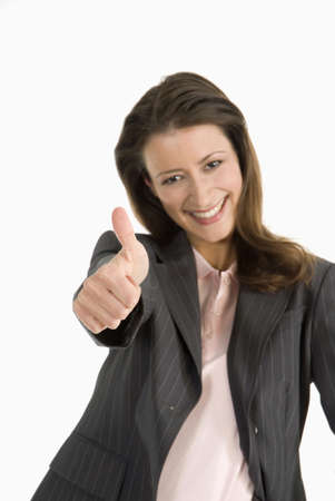 Businesswoman with thumb up, smiling, portrait, close-up Stock Photo - 23853456
