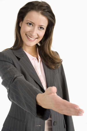 amabilidad: Mujer agitando la mano LANG_EVOIMAGES