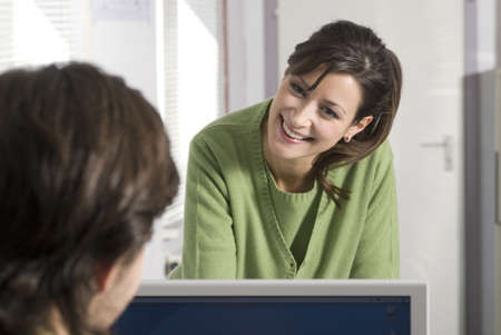 smile please: Businessman and woman talking in office, smiling