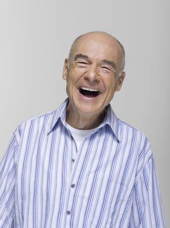 65 70 years: Senior man laughing, portrait LANG_EVOIMAGES