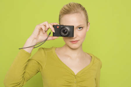 interiour shots: Woman with camera, portrait
