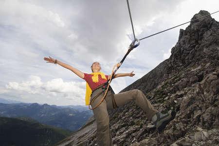 alpinism: Austria, Salzburger Land, young woman mountain climbing LANG_EVOIMAGES