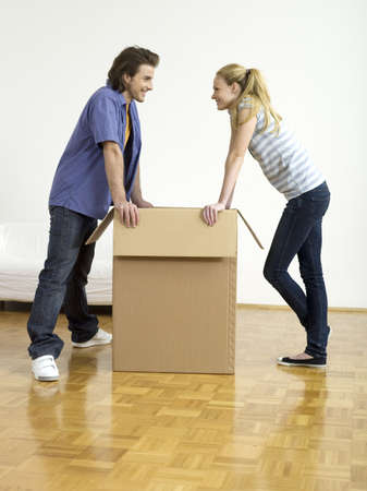 accrued: Couple leaning on box, face to face