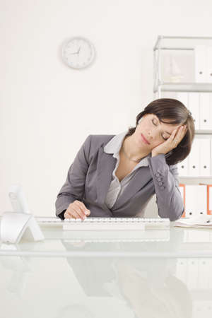 overstress: Businesswoman weary with working, hand to head