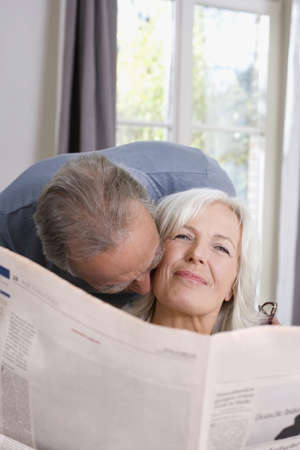 Senior man kissing senior woman, portrait Stock Photo - 23891006