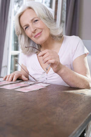 Senior woman playing Solitaire, portrait Stock Photo - 23891008