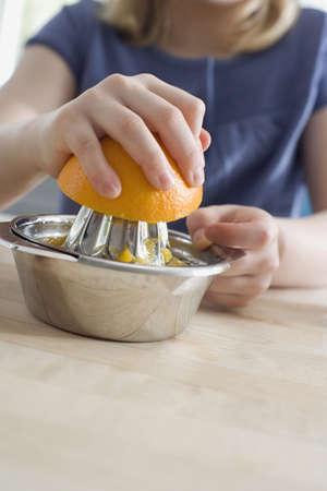 interiour shots: Preparing fresh orange juice LANG_EVOIMAGES