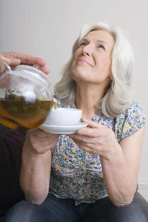 politeness: Senior woman looking up, portrait