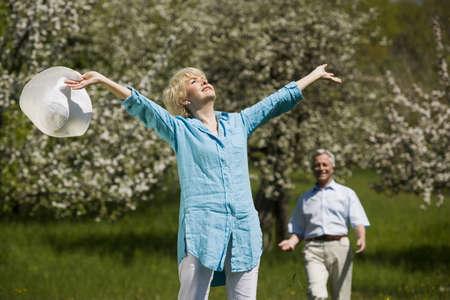 zest for life: Germany, Baden Württemberg, Tübingen, Senior Woman bathing in Sunlight, senior man in background