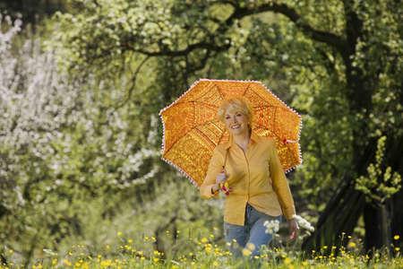 65 70: Germany, Baden Württemberg, Tübingen, Senior woman with umbrella