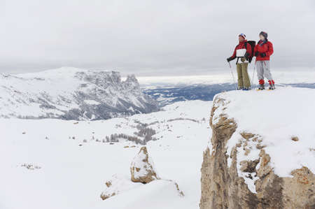 snowshoes: Italy, South Tyrol, Couple witn snowshoes standing on mountain top