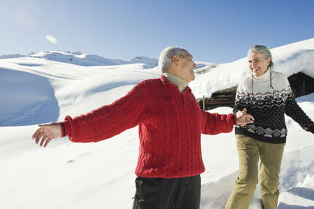 Italy, South Tyrol, Seiseralm, Senior couple in winter scenery Stock Photo - 23891067