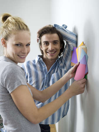 accrued: Couple choosing wall paint LANG_EVOIMAGES