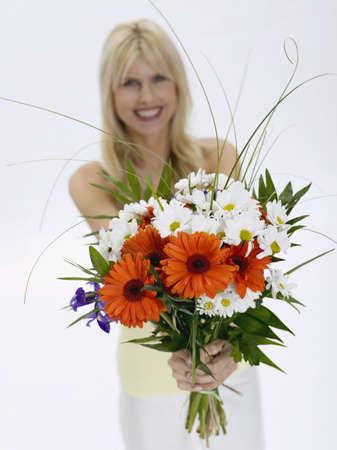 accrued: Woman holding bunch of flowers, portrait