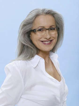 65 70 years: Senior woman wearing glasses, portrait