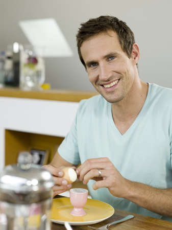 coffeepots: Man sitting at breakfast table LANG_EVOIMAGES