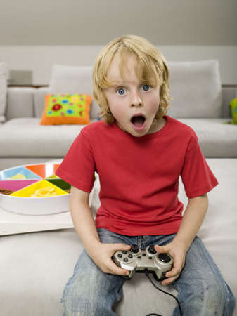 Boy playing computer game Stock Photo - 23891163