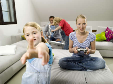 Family at home, mother playing computer game Stock Photo - 23891165