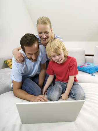 Family using laptop Stock Photo - 23891166