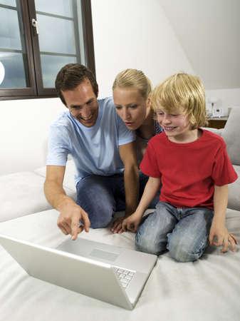 Family using laptop Stock Photo - 23891167