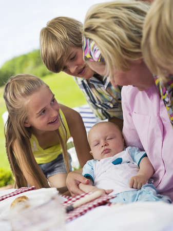 8 9 months: Family in garden with baby