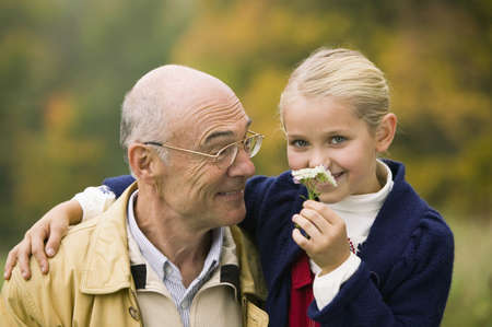65 70: Germany, Baden-Württemberg, Swabian mountains, Grandfather and granddaughter, portrait