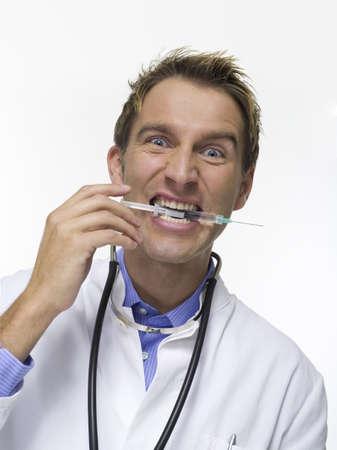interiour shots: Male Doctor with Syringe, portrait LANG_EVOIMAGES
