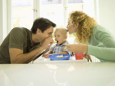 age 20 25 years: Young family, father feeding baby boy, (12-24 months)