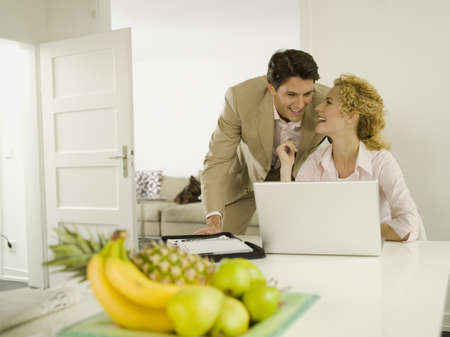 rely: Young man watching, woman using laptop