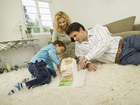 family owned: Young family in living room
